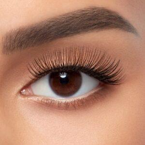 Model wearing a pair of B curl eyelash extensions